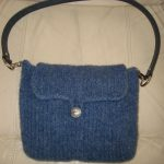 Courtney-Handy medium size purse that can be hanged into a cross body with chain strap.