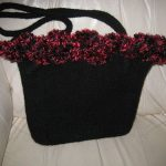Isabella Bag 2 - This black ruffle bag features maroon fur around the opening